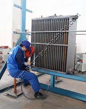 Rotating rack for radiator welding